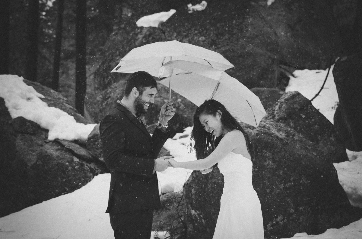 Black and White Couple Laughing in Lake Tahoe Elopement
