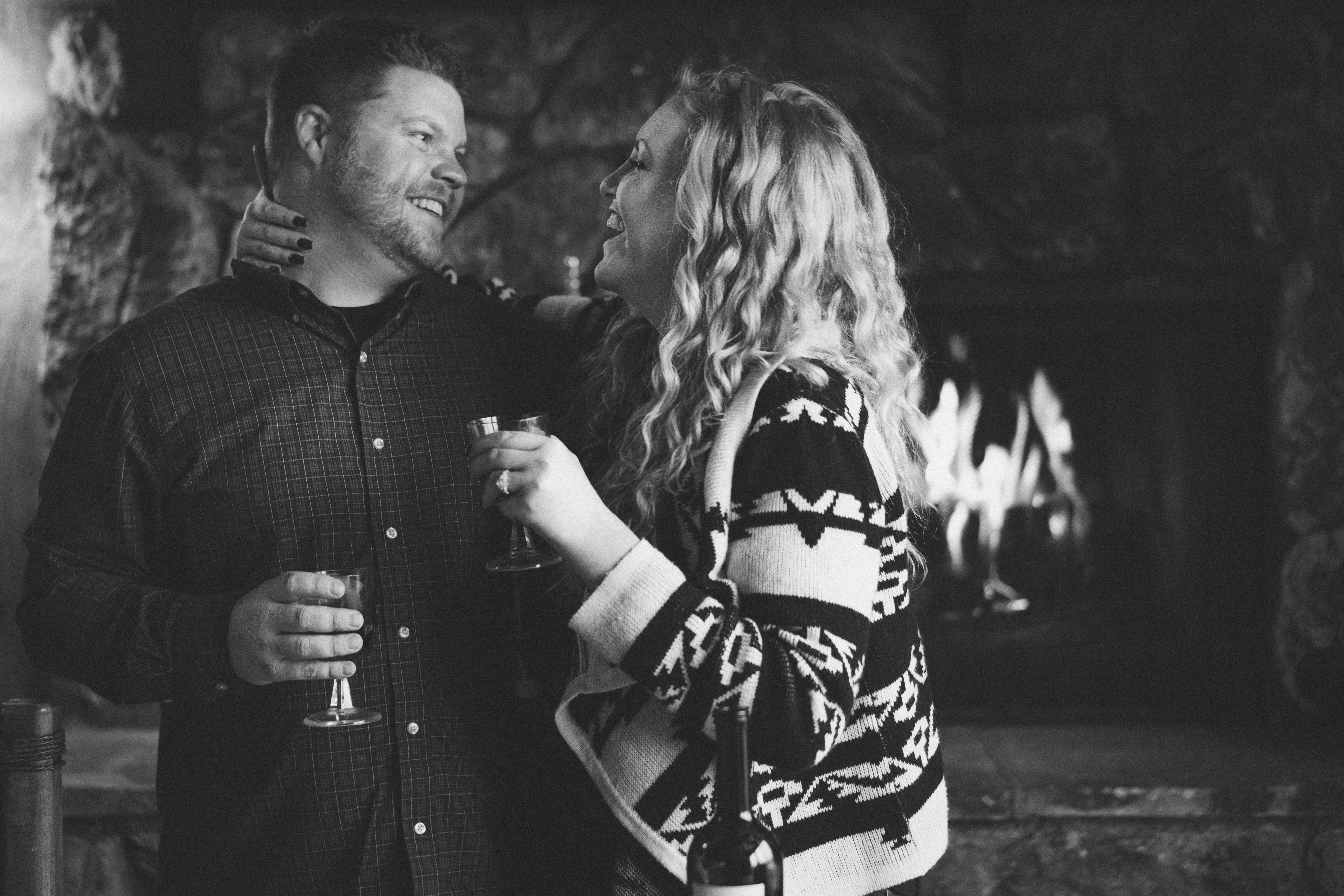 Couple drinking wine in black and white