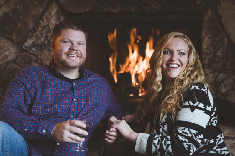 Couple drinking wine by the fire
