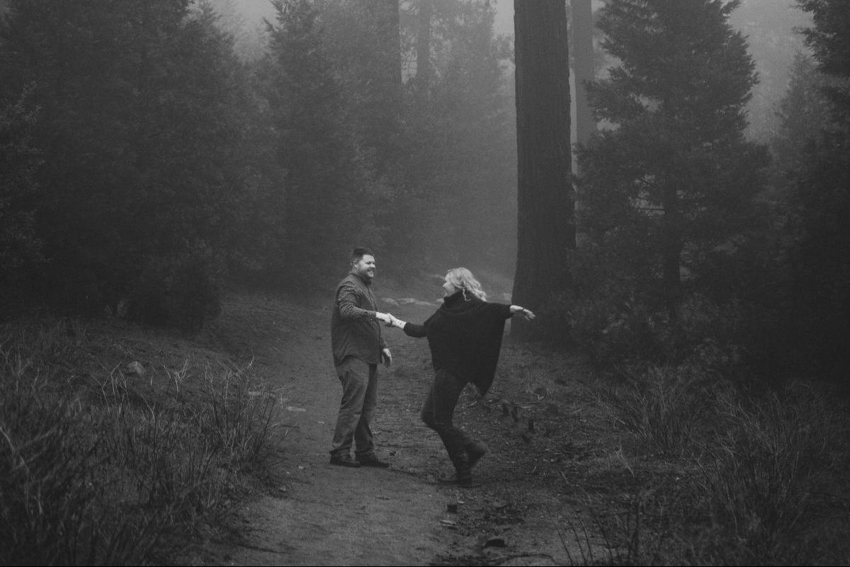 Engaged Couple Dancing in the Forest