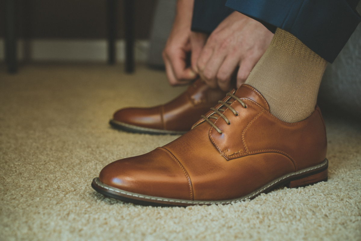 Groom putting on shoes