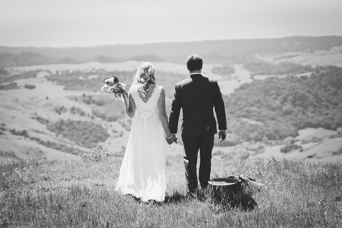 black and white couple walking on top of the world