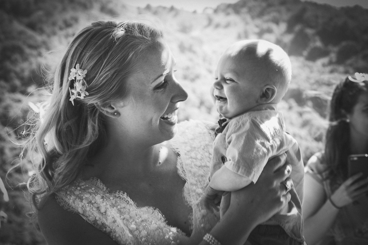 bride holding adorable baby