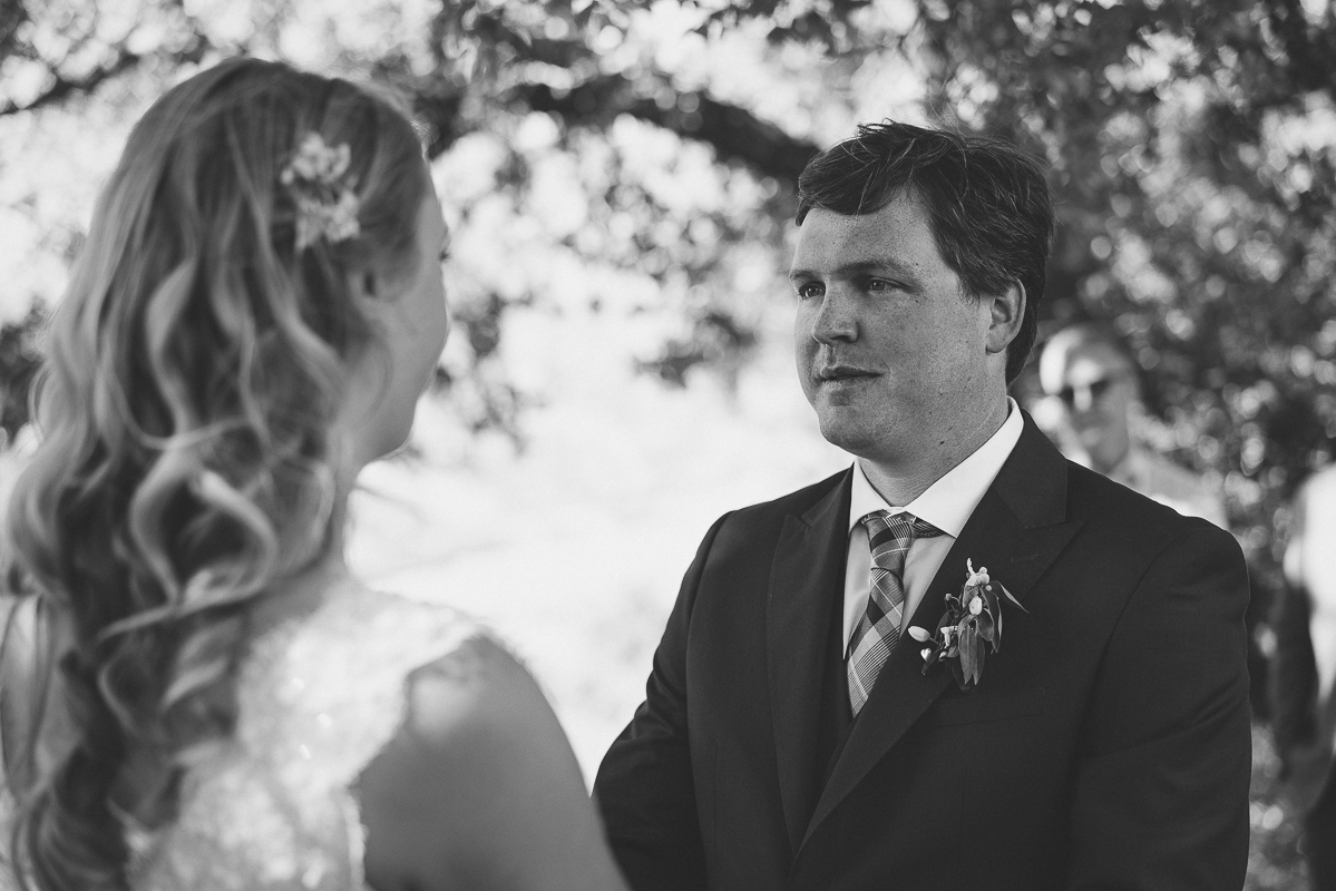 Groom looking at his bride's eyes