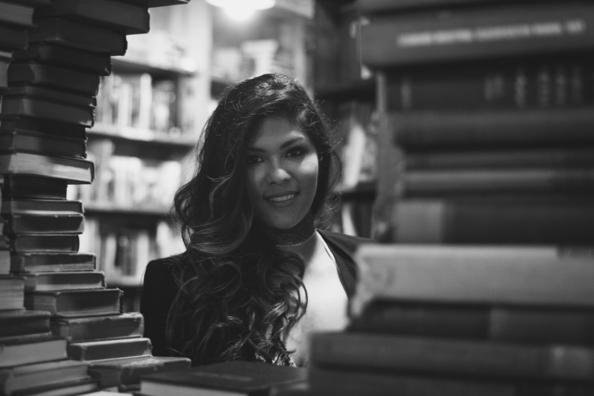 Beautiful bride to be in the circle of books in Downtown LA