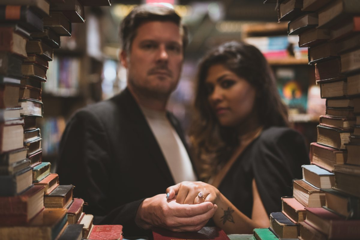 Engagement ring surrounded by books