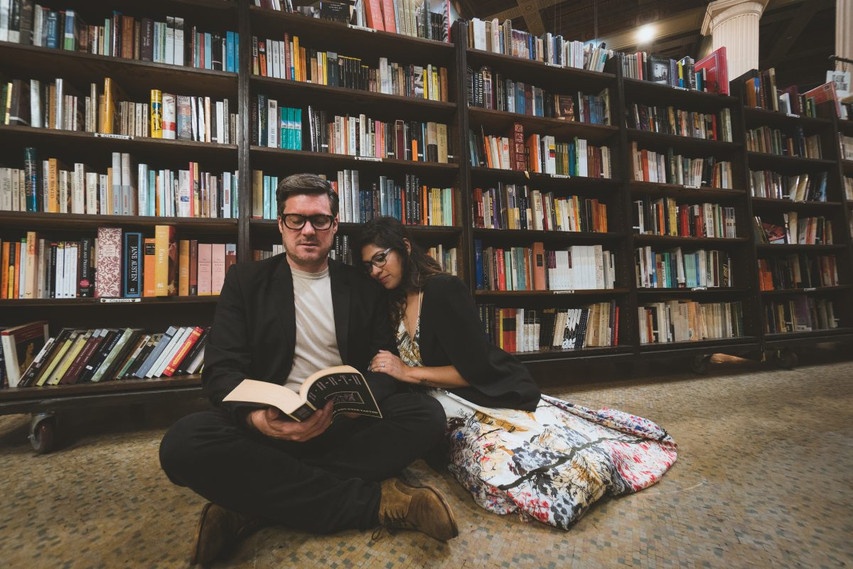 Couple reading in The Last Bookstore in Downtown LA