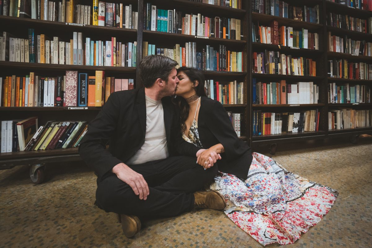 Couple kissing in a bookstore