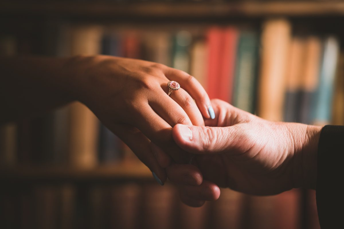 Beautiful engagement Ring surrounded by books