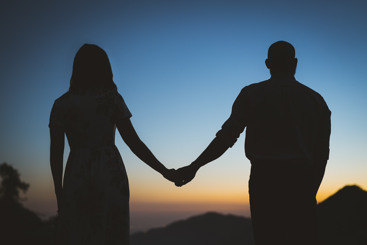 Engaged couple enjoying the sunset