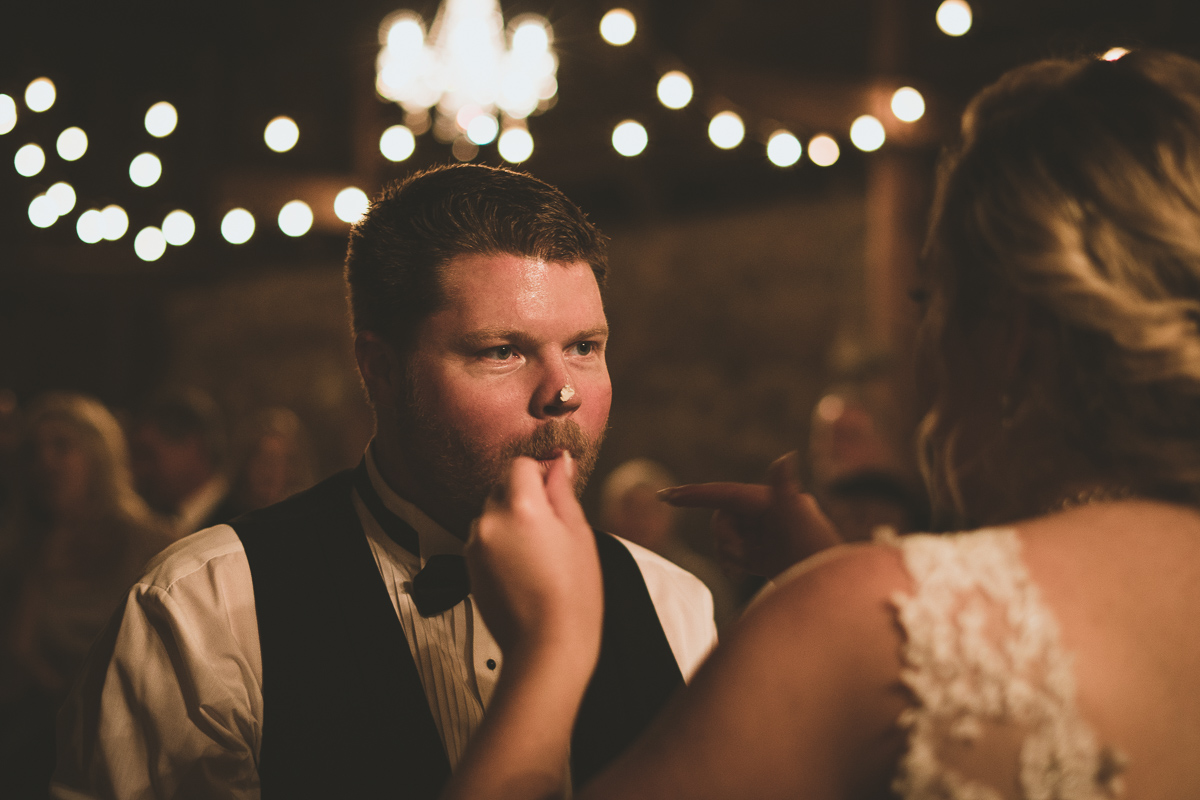 groom with cake on his face