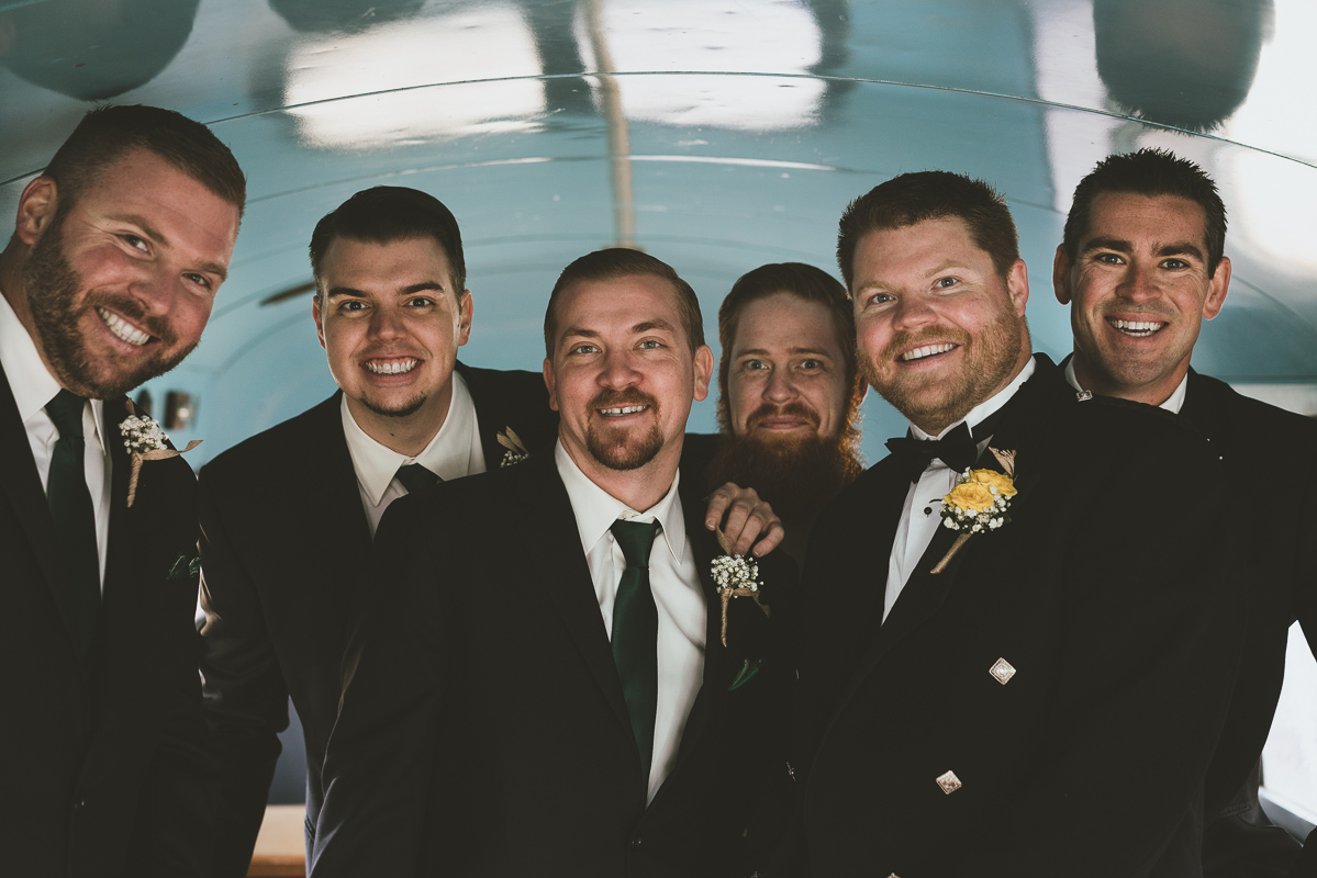 groom and his groomsmen inside a bus