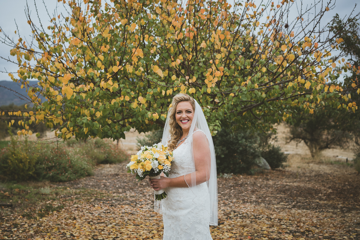 bride's portrait by yellow fall tree