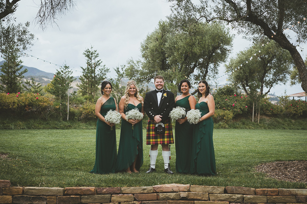 Groom and the bridesmaids smiling