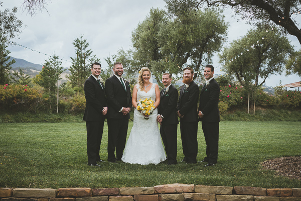 Bride and the groomsmen smiling