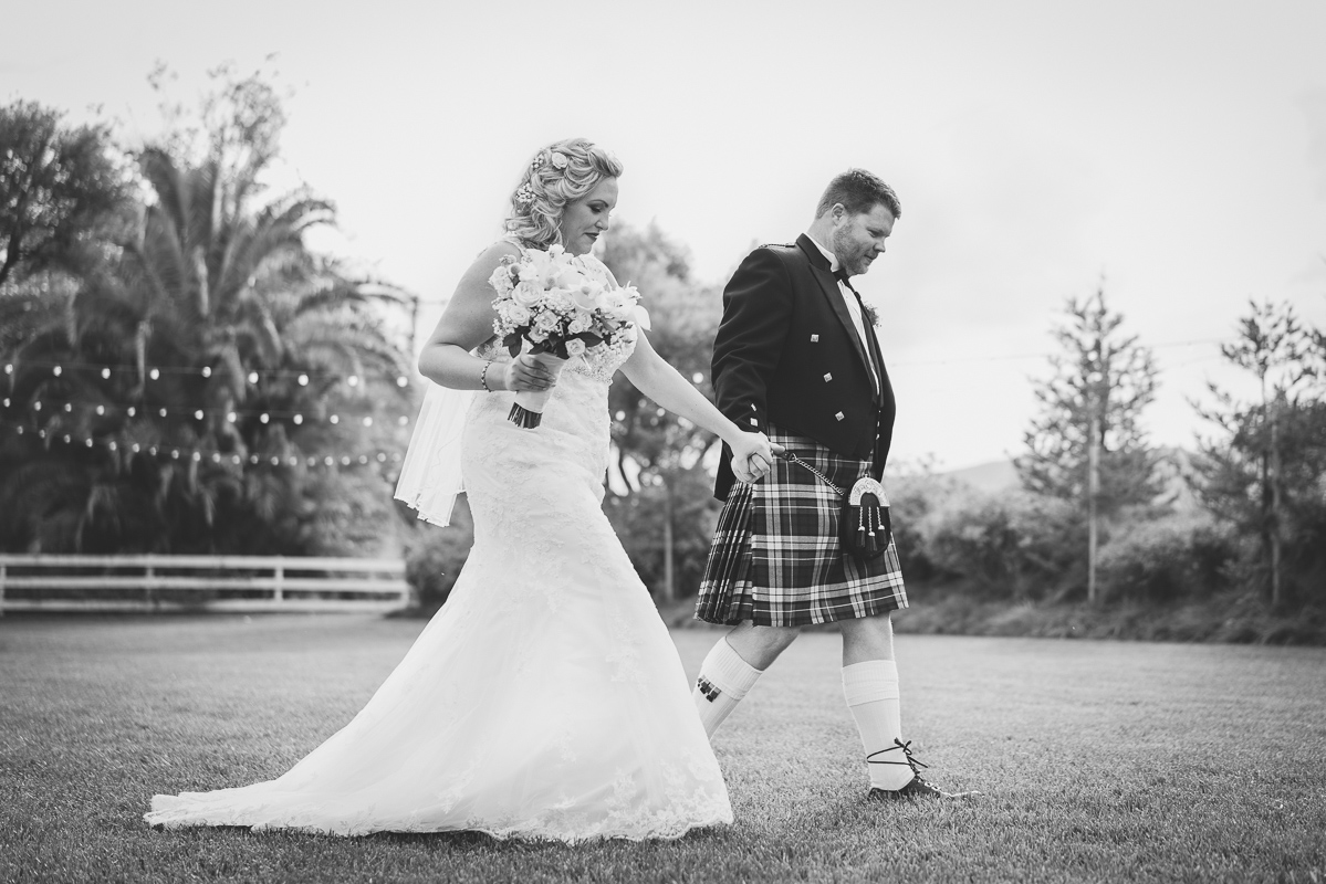 candid black and white of husband and wife