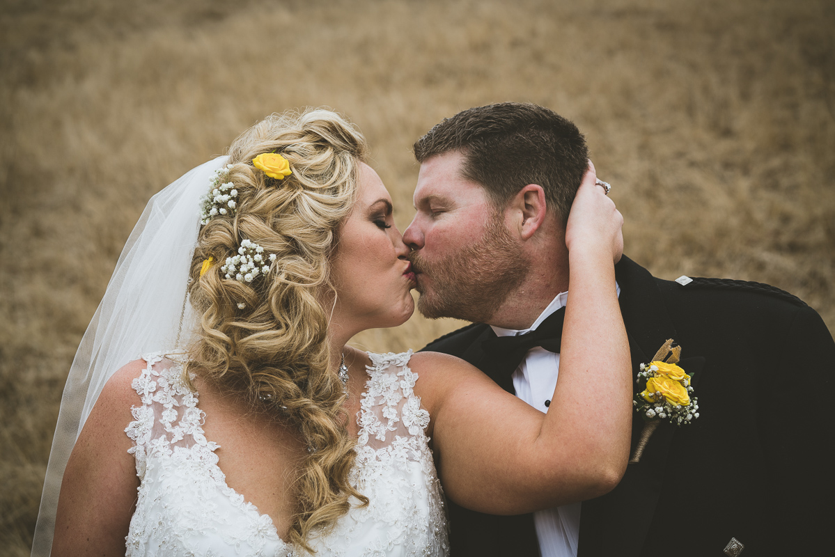 Bride and groom passionate kiss