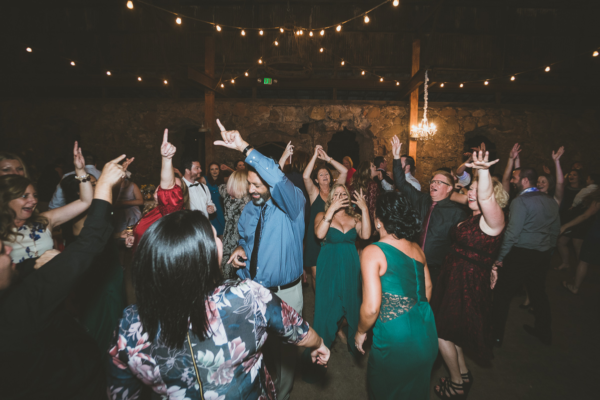 group of friends dancing and singing