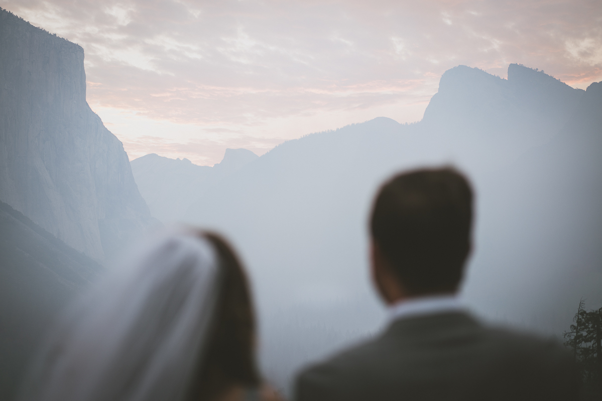 Husband and wife staring at Yosemite landscape