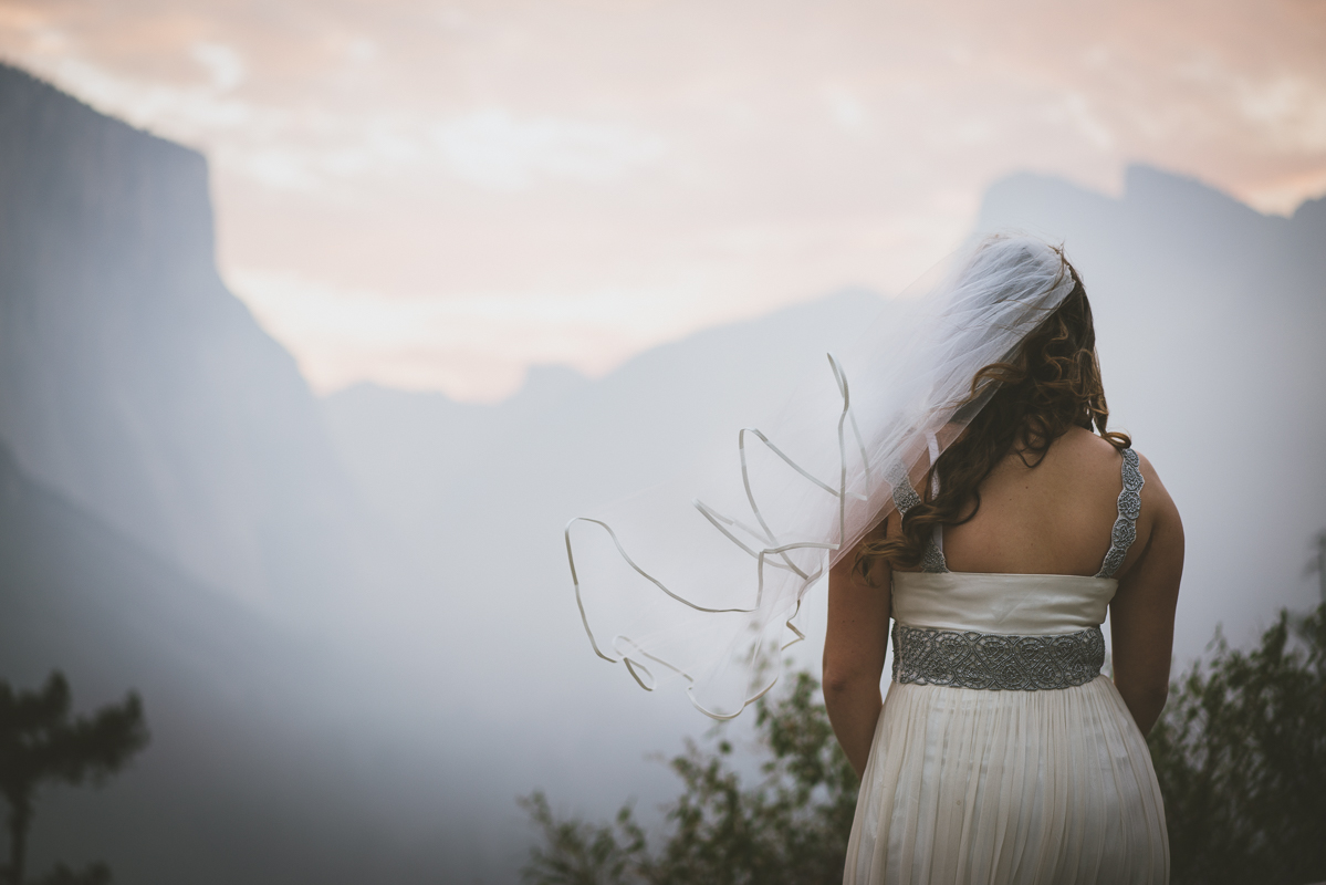 Bride staring at Yosemite landscape