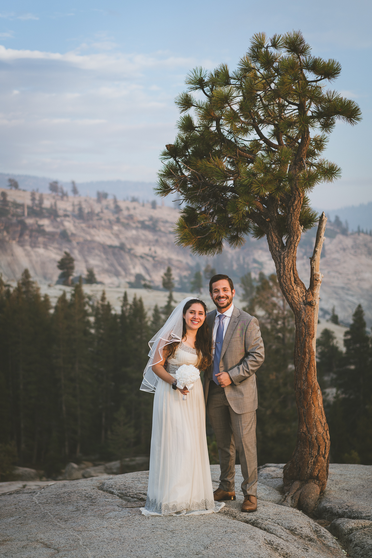 Bride and groom with Yosemite tree