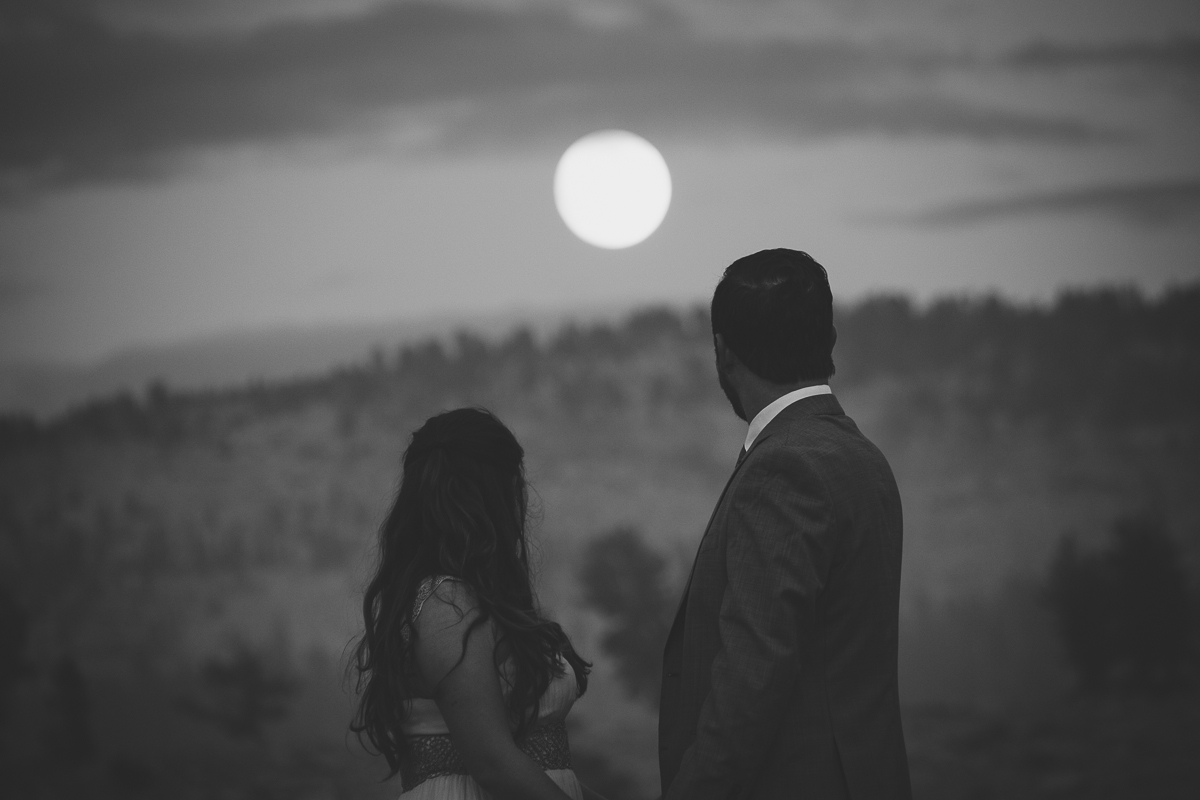 Lovers staring at the full moon
