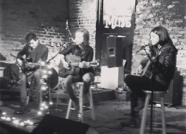 Jesse Thomas and band playing at The Evening Muse