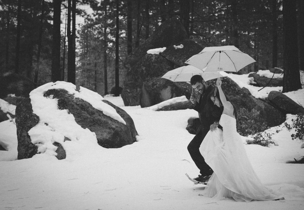 Married Couple Walking Through Snow