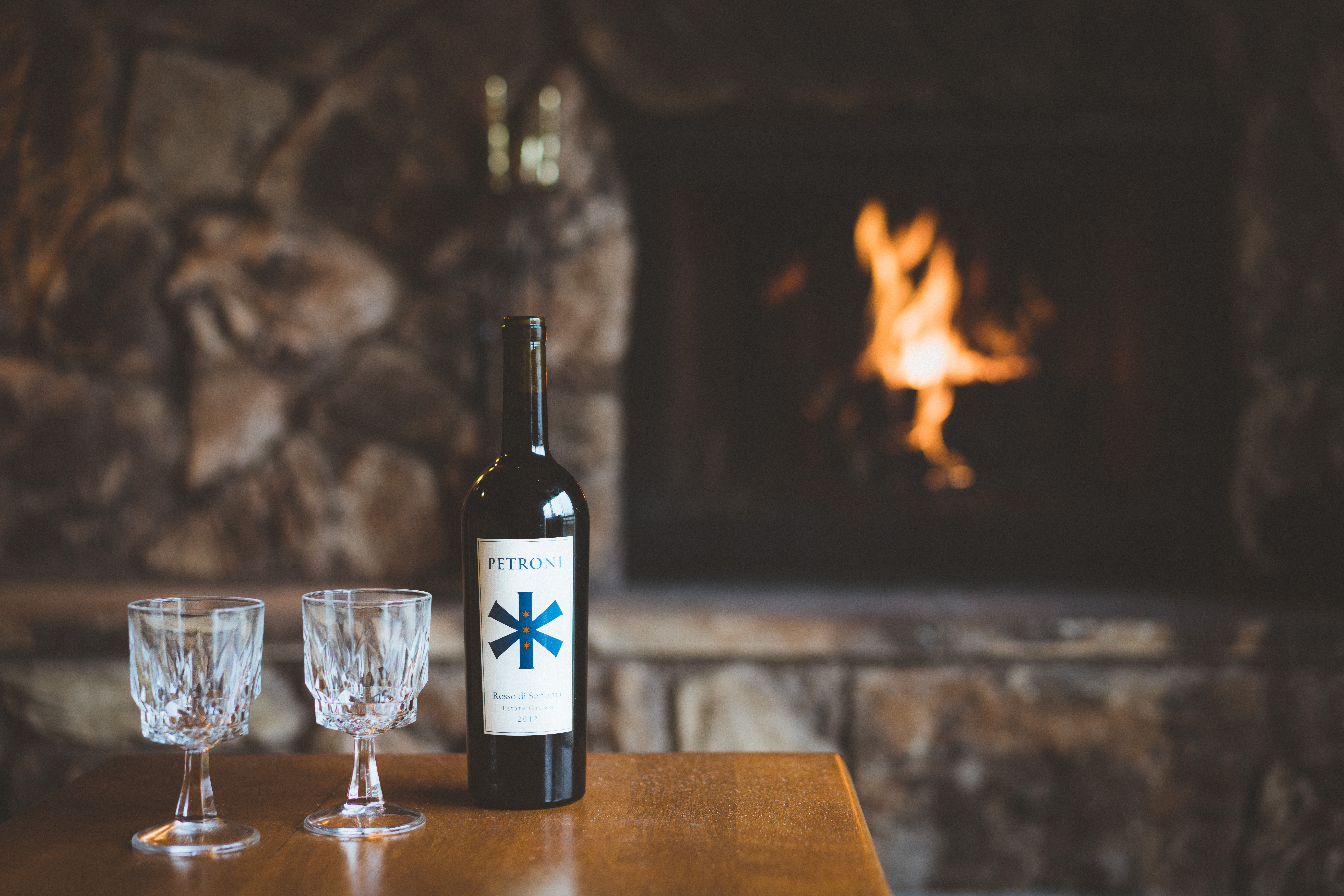 Wine tasting in by the fire