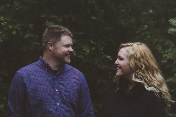 Happy Engaged Couple In the Forest