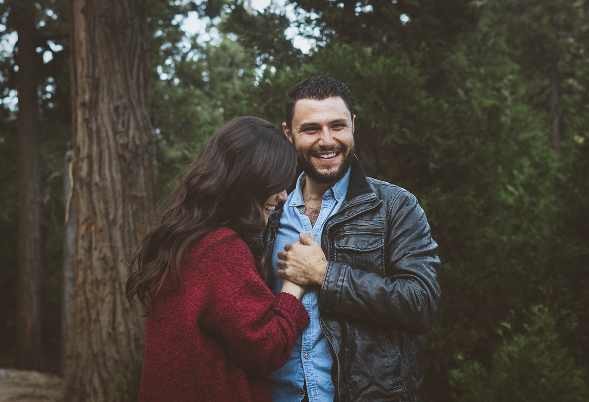 couple laughing in the woods