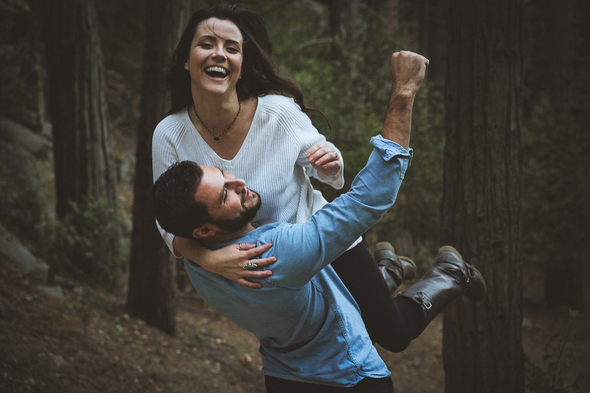 man carrying fiance outdoor engagement