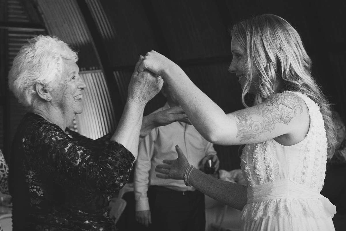 the bride and her grandmother share a dance