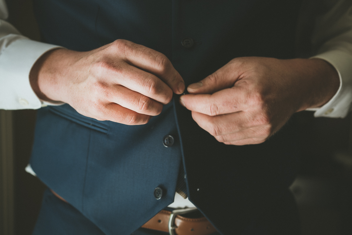 Groom buttoning up