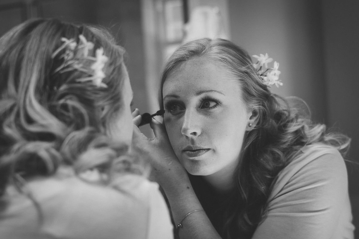 mirror reflection of bride doing her make up