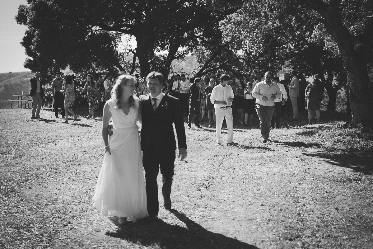 husband and wife walking to their reception