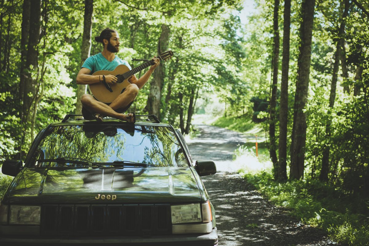 Mike Playing Guitar on Our Summer Road Trip