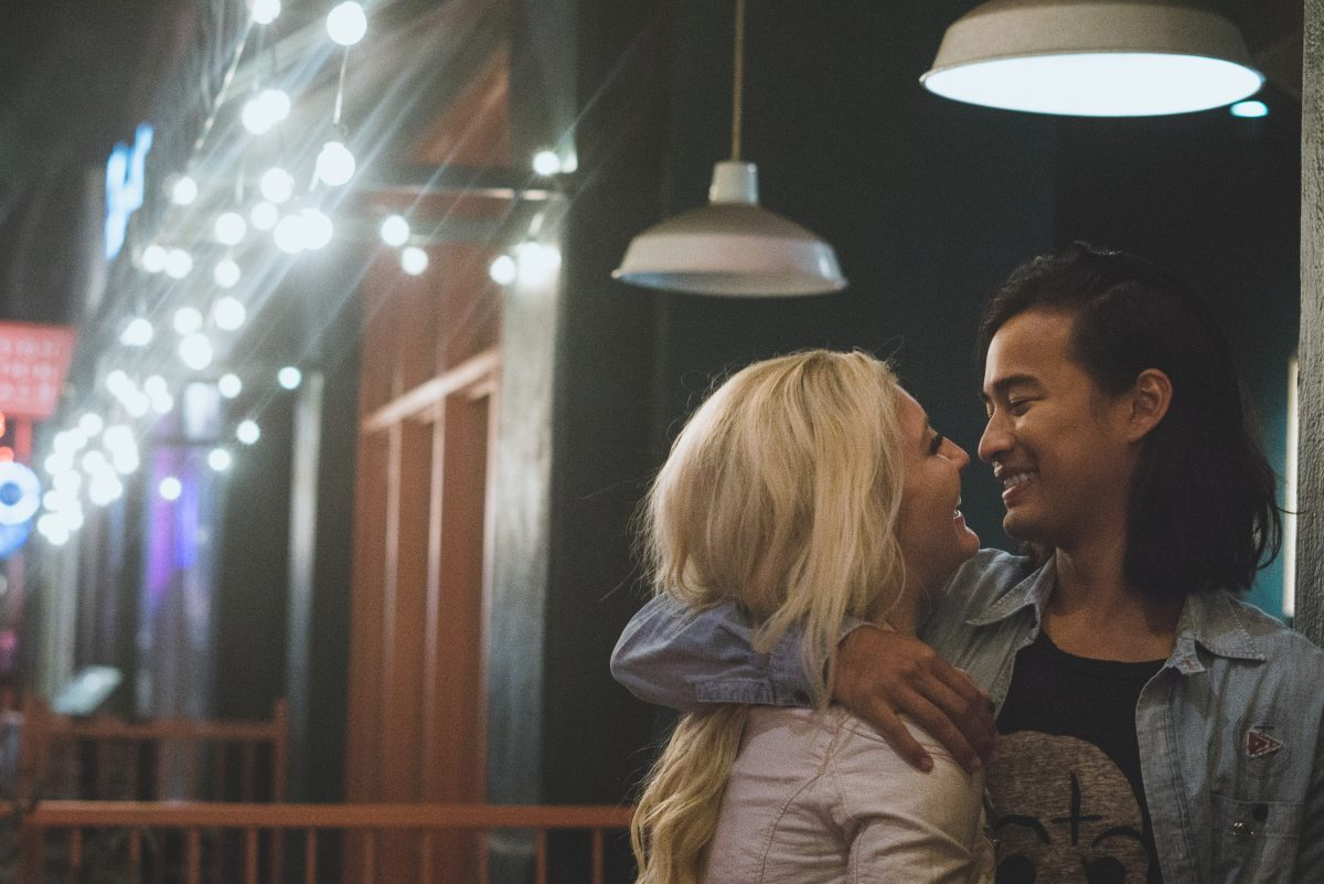 Couple smiling under the light