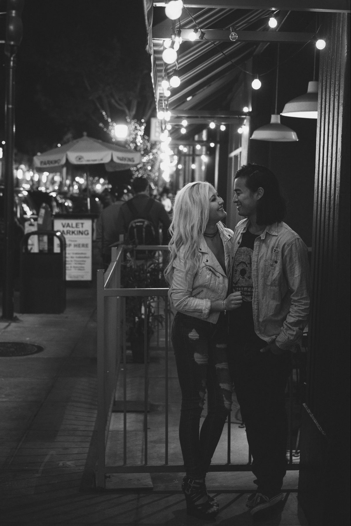 Lovers smiling under the city lights