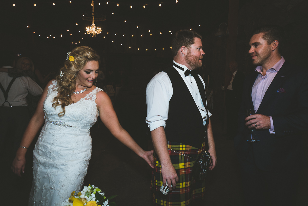 Funny candid moment between bride and groom