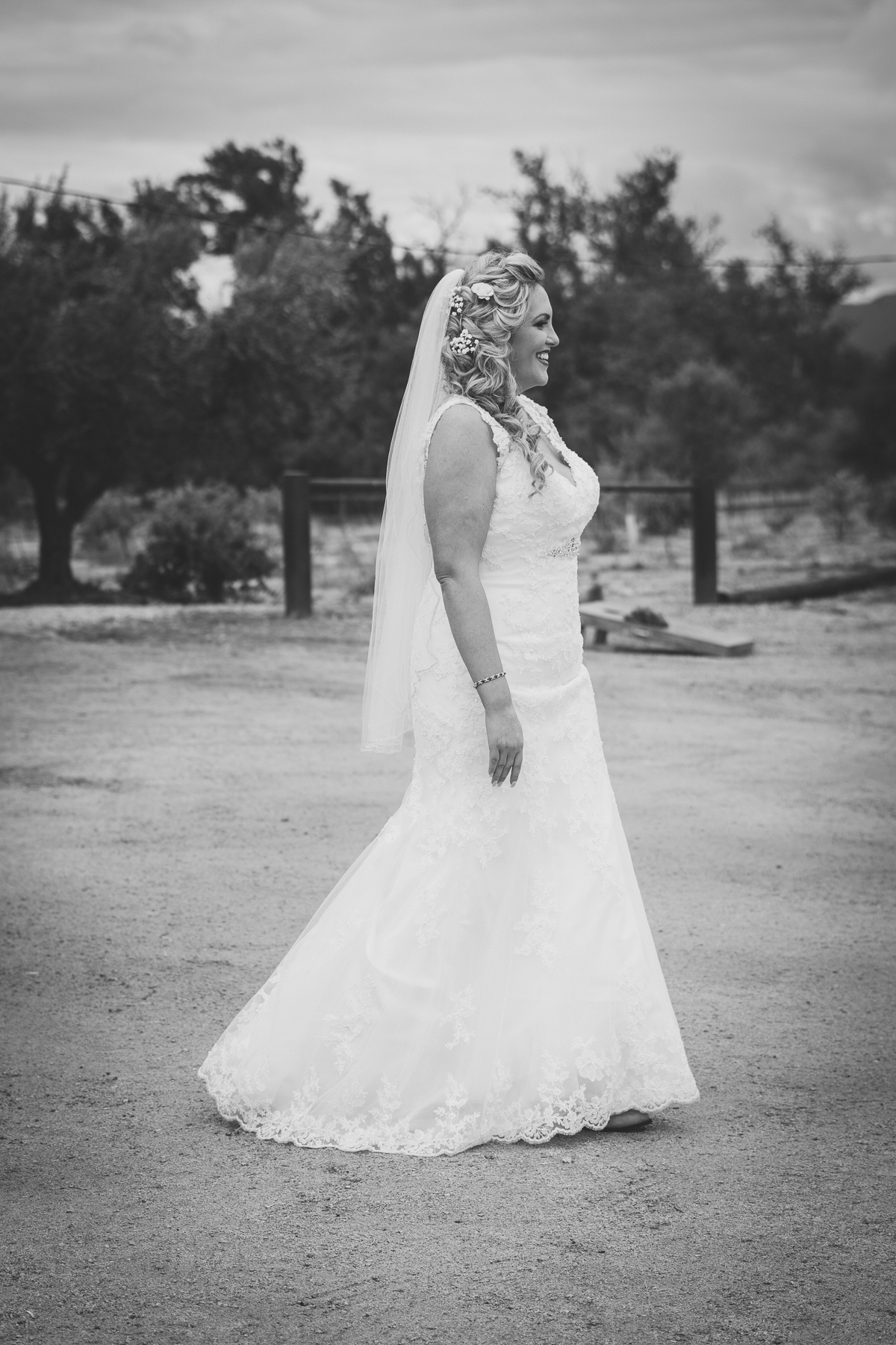 black and white bride walking towards groom