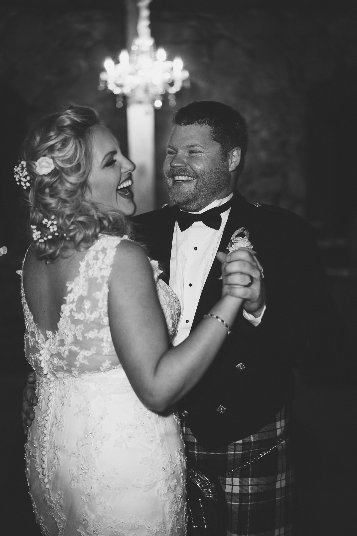 Black and white shot of newlyweds dancing