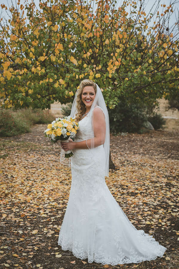 bride and yellow fall tree