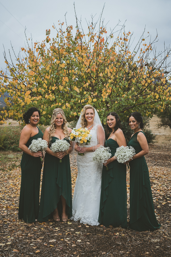 bride and bridesmaids with yellow fall tree