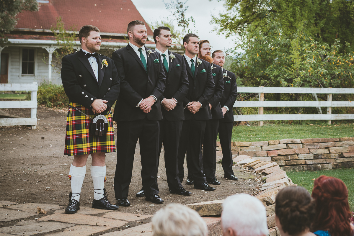 groom and his groomsmen waiting for the bride
