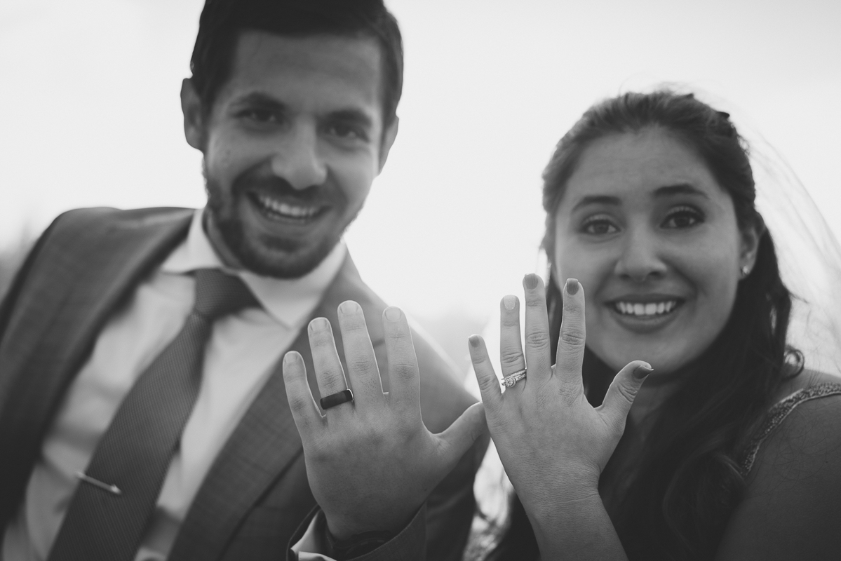 Married couple showing off their wedding rings